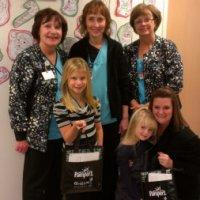 NICU nurses with preemie family