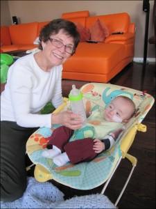 Home health nurse feeding premature baby