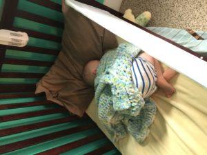 Preemie sleeping in crib