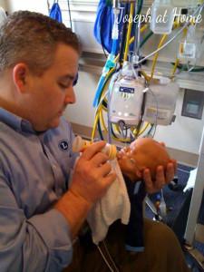 Scott and J feeding in NICU